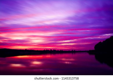 Sunset on the river Desna, Chernihiv region, Ukraine. Beautiful colorful skys above the river in the evening.