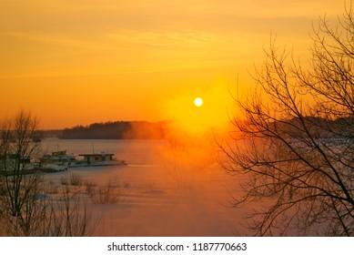 Sunset on the river Kostroma in winter. Kostroma, Russia.
