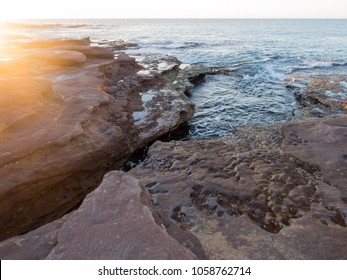 Sunset on rocky beach, Red Bluff, Kalbarri, Western Australia