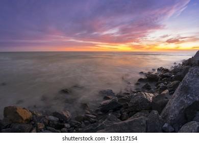 Sunset on a rocky coast