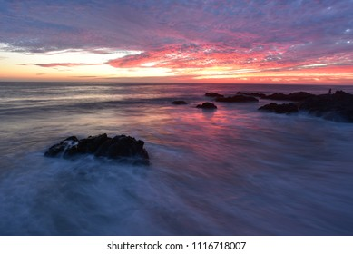 sunset on rocky coast of Pacific Ocean in Baja, Mexico