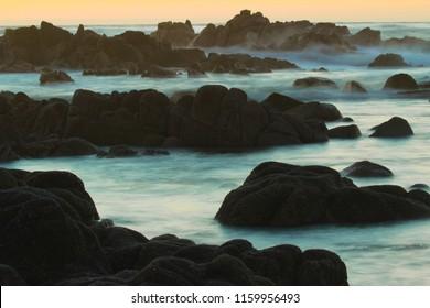 Sunset on rocky coastline of Pacific Grove, near Monterey and Carmel, California, USA
