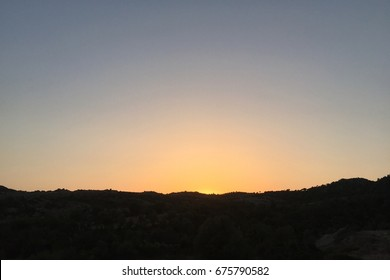 Sunset on the rocky hill