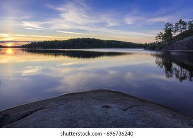 Sunset on a rocky lake