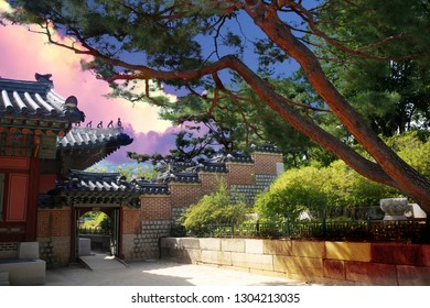 Sunset on the rooftops and trees of the Gyeongbokgung palace in Seoul. South Korea.