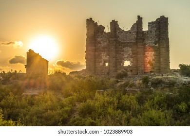 Sunset on the ruins of the ancient city. Very warm shade and green vegetation.