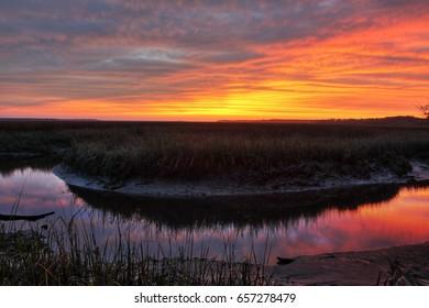 Sunset on a salt marsh near the Saint Mary`s River in Saint Mary`s, Georgia.