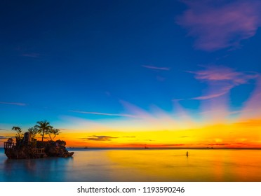 Sunset on the sandy beach in Boracay, Philippines. Copy space for text