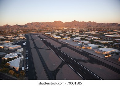 Sunset on Scottsdale Airport and the McDowell Mountains