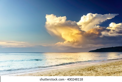 Sunset on a sea beach with fantastic sky clouds. Twilight reflection Phuket, Thailand. Amazing sunset vacation in Asia. Soft sunset reflection in sea water, Karon beach Phuket. Exotic sea view at dusk