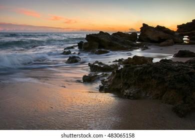 Sunset on a sea beach. Sunset light reflection. Amazing sunset. Sunshine