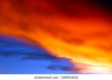 sunset on sea and colorful flame cloud cold collide on sky