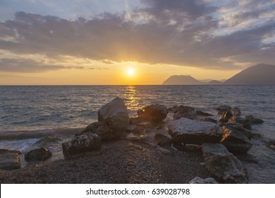 Sunset on the sea and the mountains on the horizon