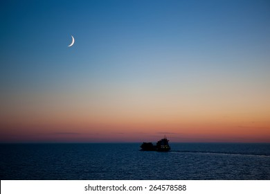 sunset on the sea with new moon