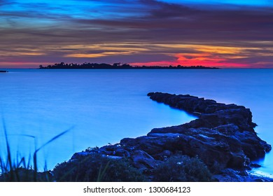 Sunset on the sea and rocks