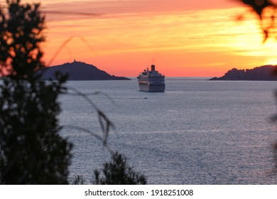 Sunset on the sea with silhouettes of Palmaria Island and Portovenere promontory and cruise ship.