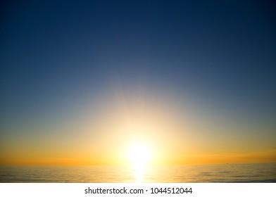 sunset on the sea. The sun sets over the sea horizon