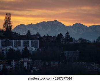 Sunset on Seattle Residential Houses with Olympic Mountains