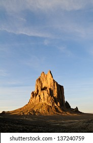 Sunset on Shiprock in the New Mexico desert with blue sky