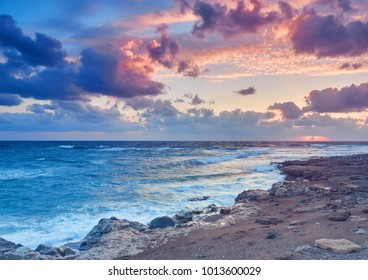 Sunset on the shores of the Mediterranean Sea off the coast of Cyprus