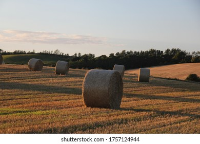sunset on a summer day with hay bales