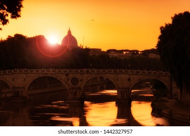 sunset on Tiber river, Tevere, in Rome with St Peter dome