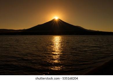 Sunset on the top of Mount Fuji (Diamond fuji) at lake yamanaka (Yamanakako), Yamanashi, Japan.