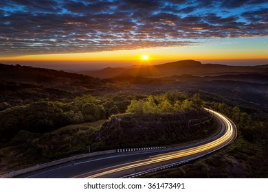 Sunset on the top mountain and road at front