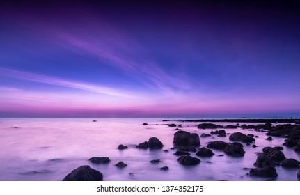 Sunset on tropical beach at Koh Lanta, Krabi, Thailand.