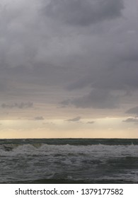 Sunset on the Versilia beach. Cloudy sky and gray sea in this sunset photographed in Viareggio.