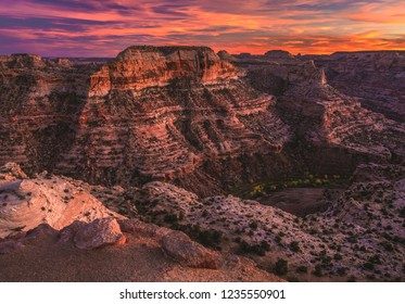 "Sunset on the Wedge Overlook of the San Rafael Swell, also called the ""Little Grand Canyon"" in central Utah, USA. Autumn had just begun to turn colors on the aspens and cottonwood trees in the canyon."