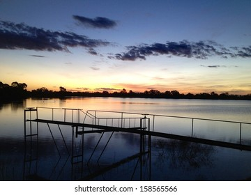 Sunset on the Weir at the Cotton Farm