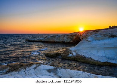 Sunset on white stones in Cyprus