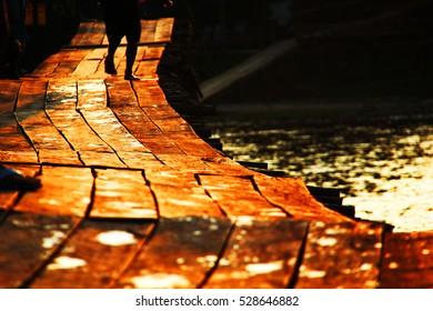 Sunset on wooden bridge