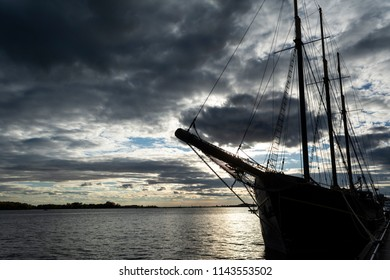 Sunset at the Ontario lake with tall ship standing at marina