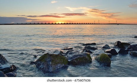 Sunset at the Oosterscheldekering seen from the island Noord-Beveland.  Province: Zeeland, Country: Netherlands
