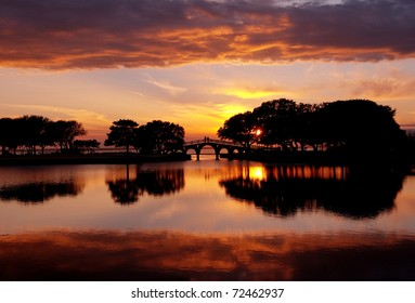 Sunset in the Outer Banks, North Carolina overlooking the Tranquility Bridge at the Whalehead Club at the Currituck Heritage Park.