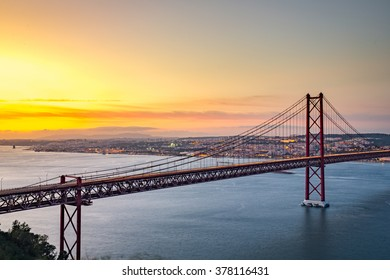 Sunset over the '25 of April' Bridge in Lisbon, Portugal.
