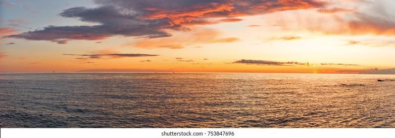 Sunset over Adriatic Sea with golden dramatic sky panorama. Solaris, Istria, Croatia.