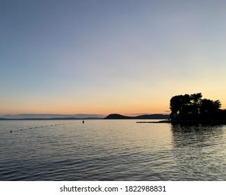 sunset over the Adriatic Sea in the port of Split, Croatia