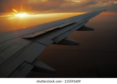 Sunset over the airplane wing