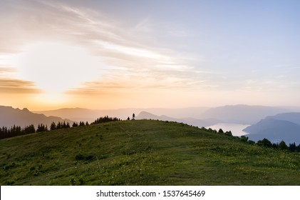 Sunset over Aix les Bains lake and mountains, in Savoie, France