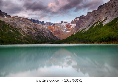 Sunset over Andes mountains reflecting in lake Laguna Esmeralda near Ushuaia in Tierra del Fuego, Argentina