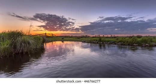 Sunset over aquatic farmland in natura 2000 area Zuidlaardermeergebied near Groningen