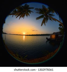 Sunset over the Ashtamudi backwaters in Kollam, Kerala, God's own country. Fisheye view.