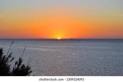 Sunset over the Atlantic Ocean in Sanlucar de Barrameda, Coast of the Light, Cadiz province, Spain