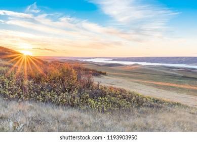Sunset over autumn leaves on a hillside overlooking Lake Diefenbaker at the Saskatchewan Landing Provincial Park