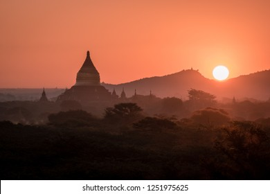 Sunset over Bagan, Myanmar taken from the top of a temple. Golden light streaming over the temples and ancient plains of Bagan. Pagan old city Burma