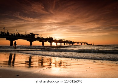 sunset over Baltic Sea coast, Miedzyzdroje in Poland.