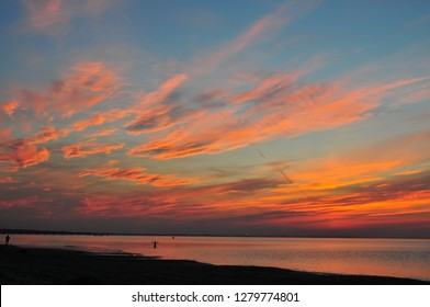 Sunset over Baltic Sea in Miedzyzdroje in Poland. Amazing red and orange clouds at sundown